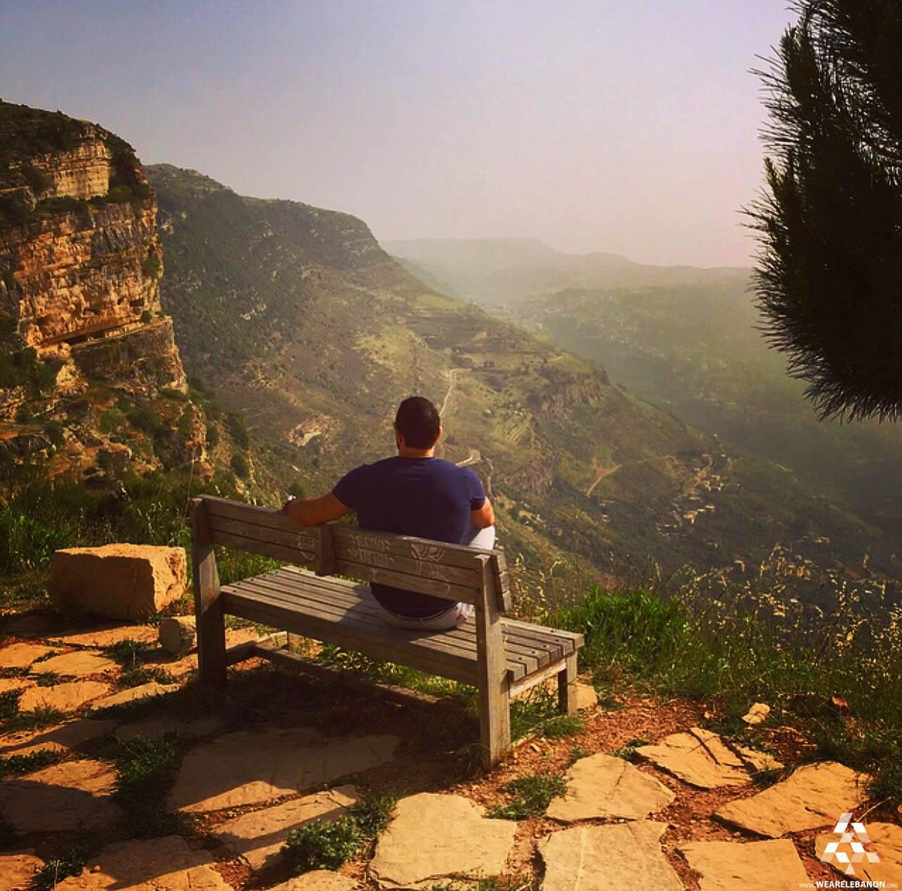 man relaxing overlooking mountain