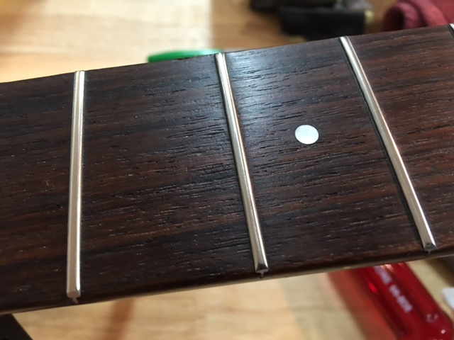 Finished frets and buffed board