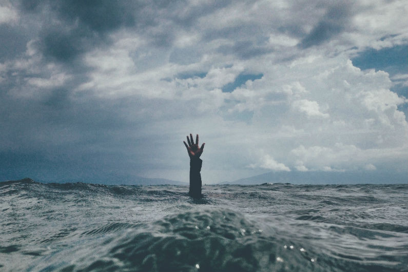 A person without help drowning anxiously