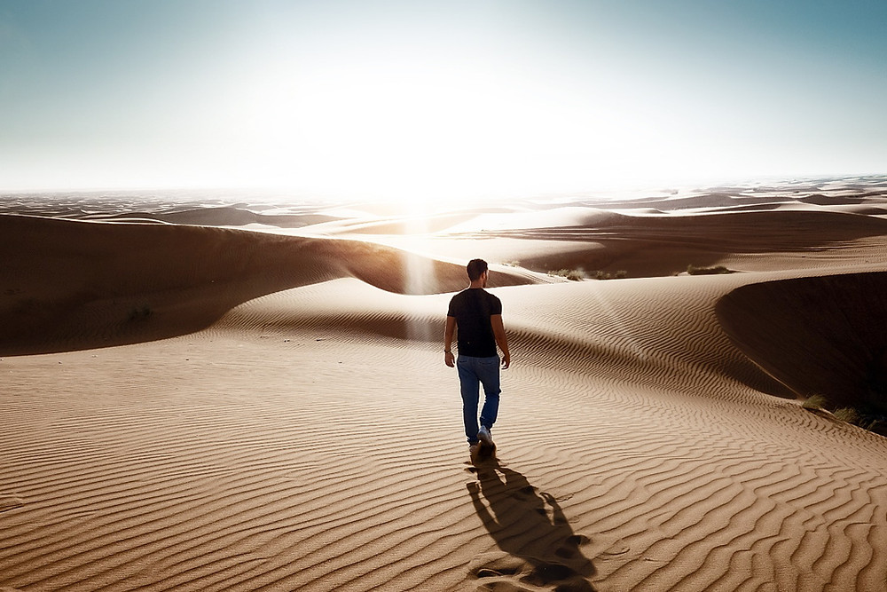 Man alone in desert to show isolation of men's mental health and how counselling can help.