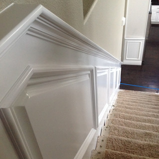 Stairway with skirt and wainscoting