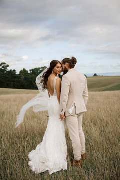 Amanda wears 'Benedetti' by Hera Couture  Photography by Toni Larsen Photography  This hot couple made their way on to the cover of NZ Weddings Magazine 2018 Issue #65