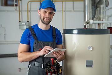 technician-servicing-an-hotwater-heater-