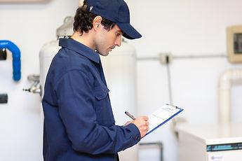 technician-servicing-an-hot-water-heater