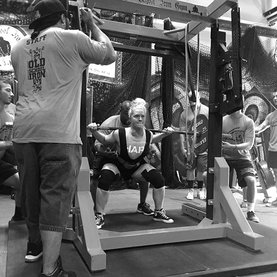 Coach Nikki at a Powerlifting Competition