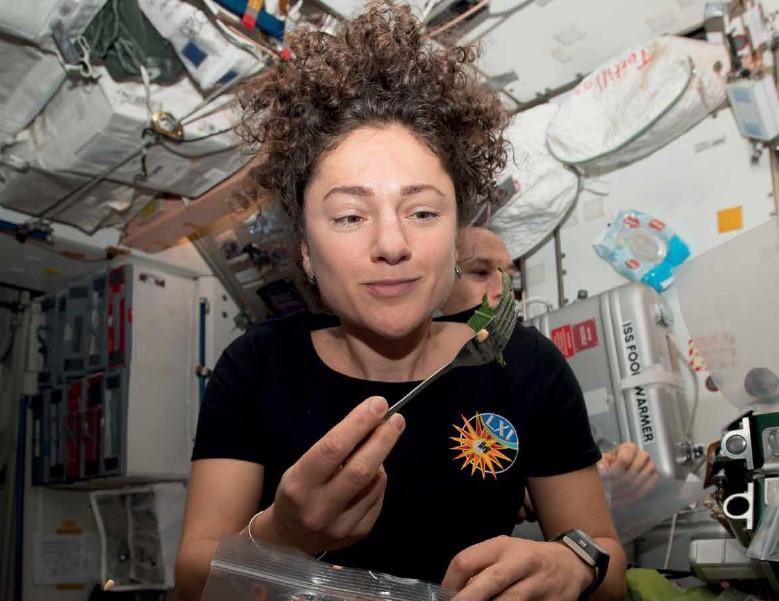 Astronaut Jessica Meir enjoys her home grown mizuna salad on the ISS.