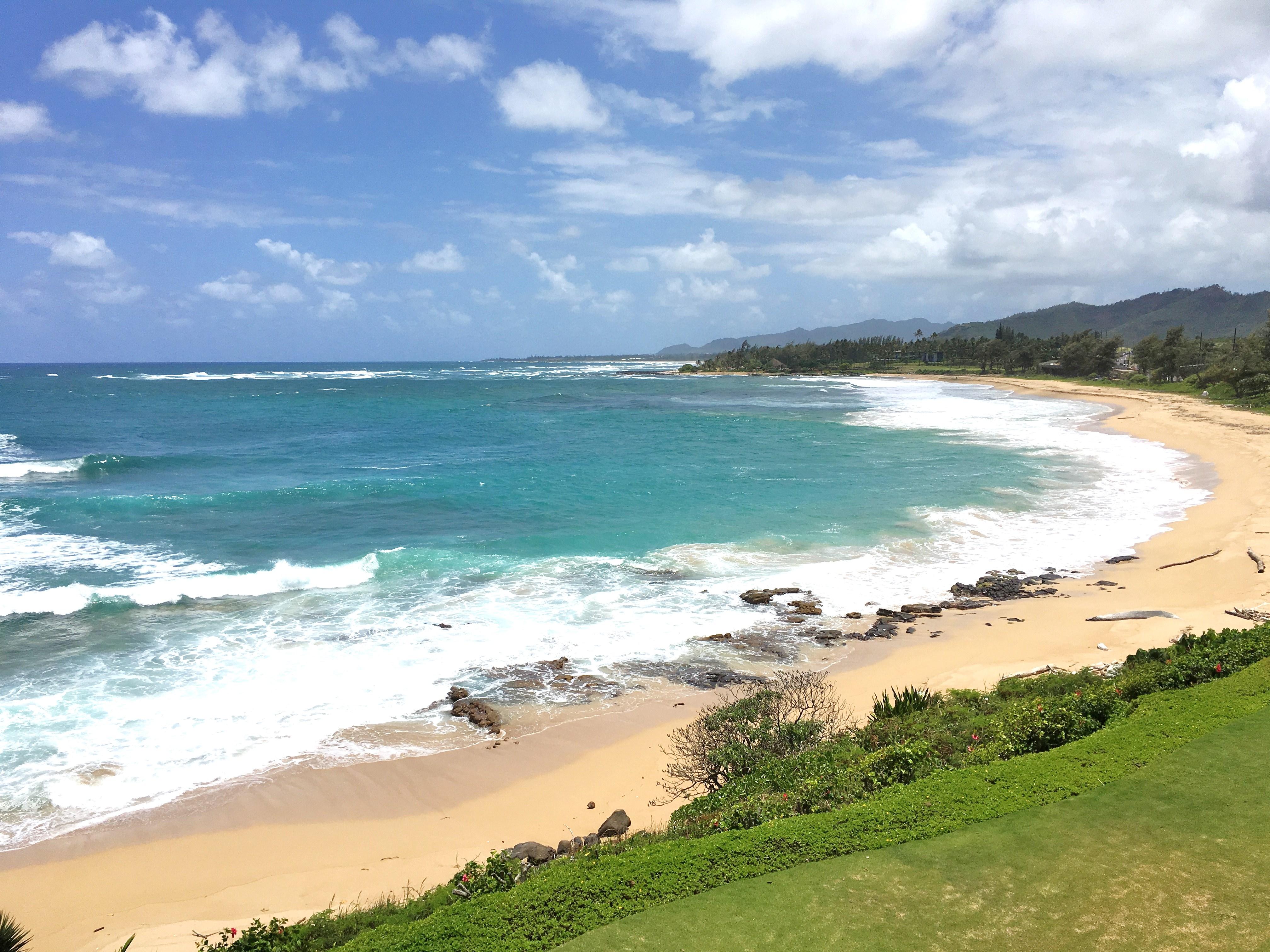 Kauai surfing beach Wailua Bay
