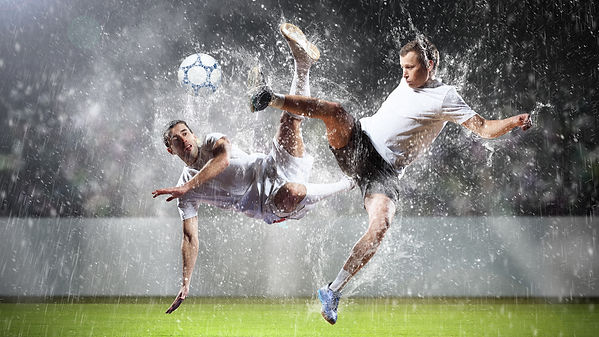 two-football-players-striking-the-ball.j
