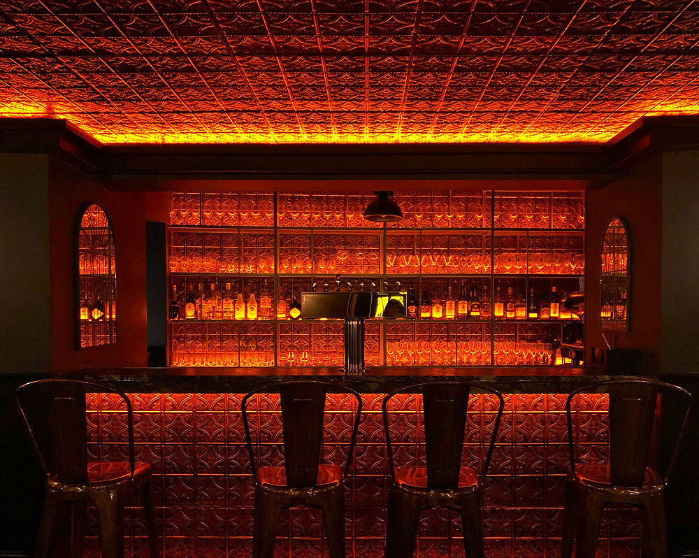 Glowing orange bar in the lobby of The Continental Hotel in Galway, Ireland