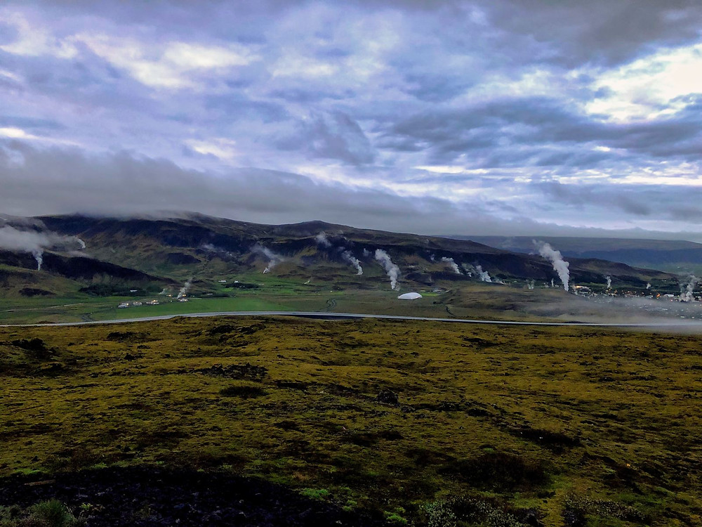 Several steam spouts rising up from the ground in Iceland
