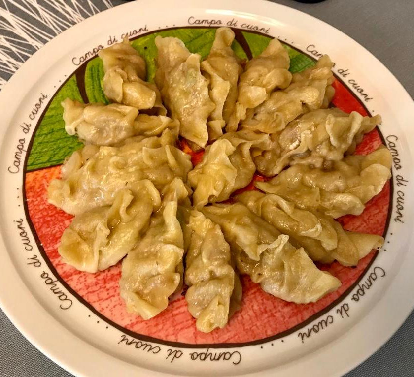 Homemade gyoza on a plate in Italy