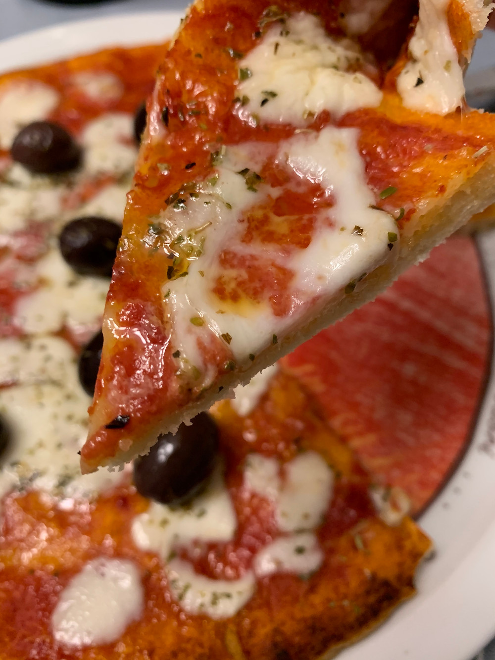 Close up of slice of pizza from Italy