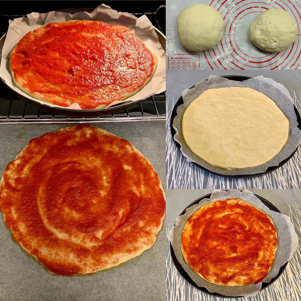 Tomato sauce spread onto pizza dough