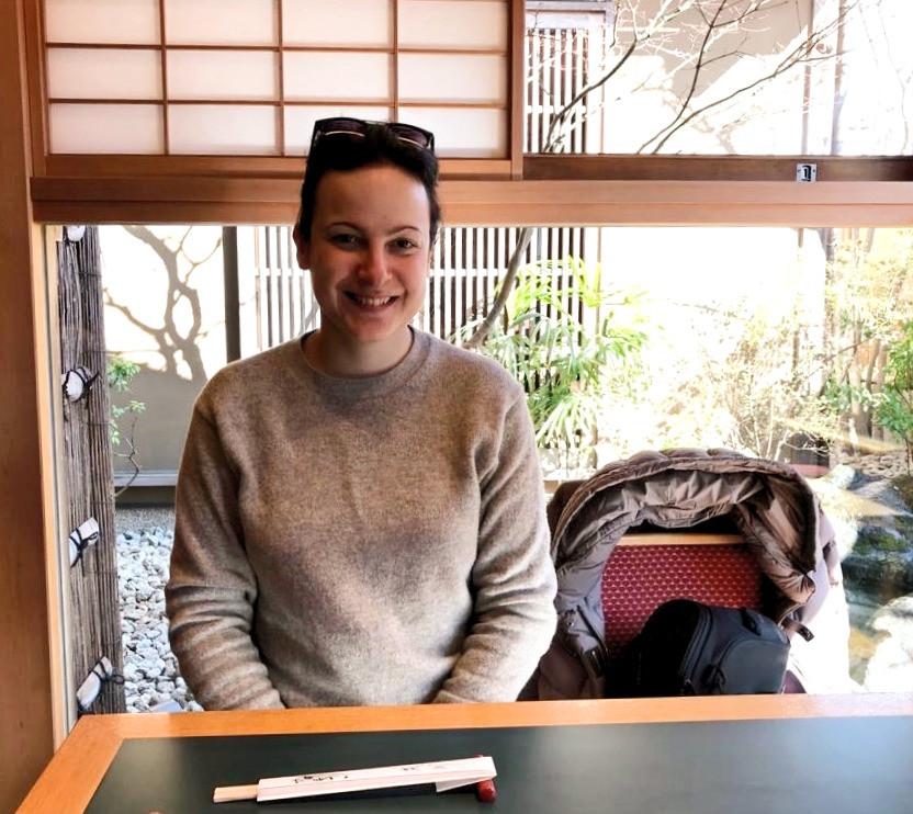 Italian female traveler sitting in Japanese restaurant