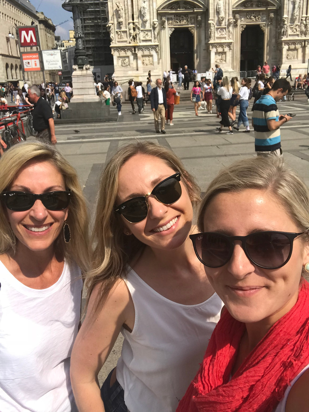 Mother and two adult daughters posing outside the Duomo in Milan