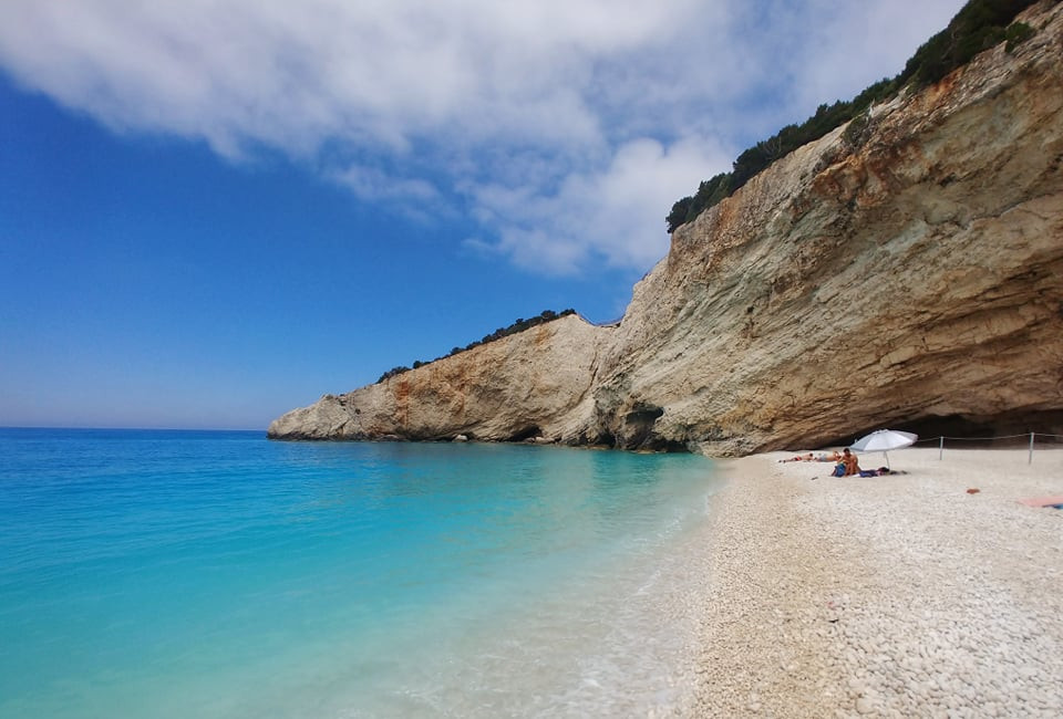 White rocky beach with white cliffs in backdrop on Lefkada, Greece