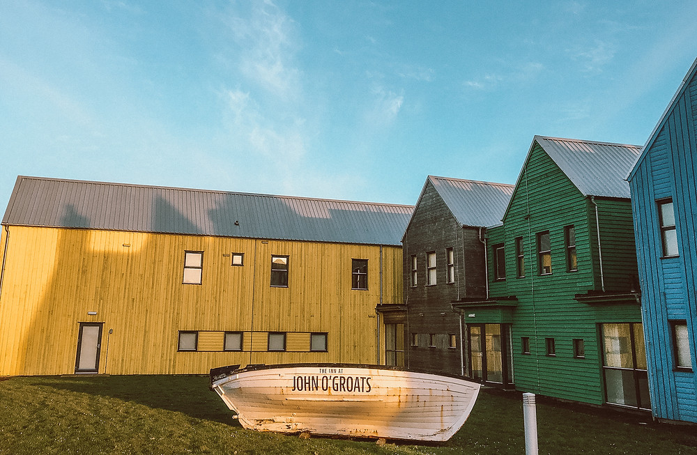 Colorful buildings that make up the renovated John O'Groats Hotel in Scotland