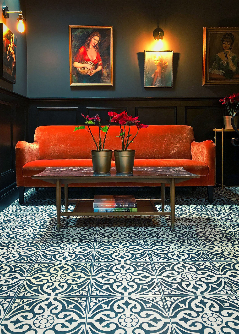 Plush orange velvet sofa and intricate floor tiling in the lobby of The Continental Hotel in Galway, Ireland