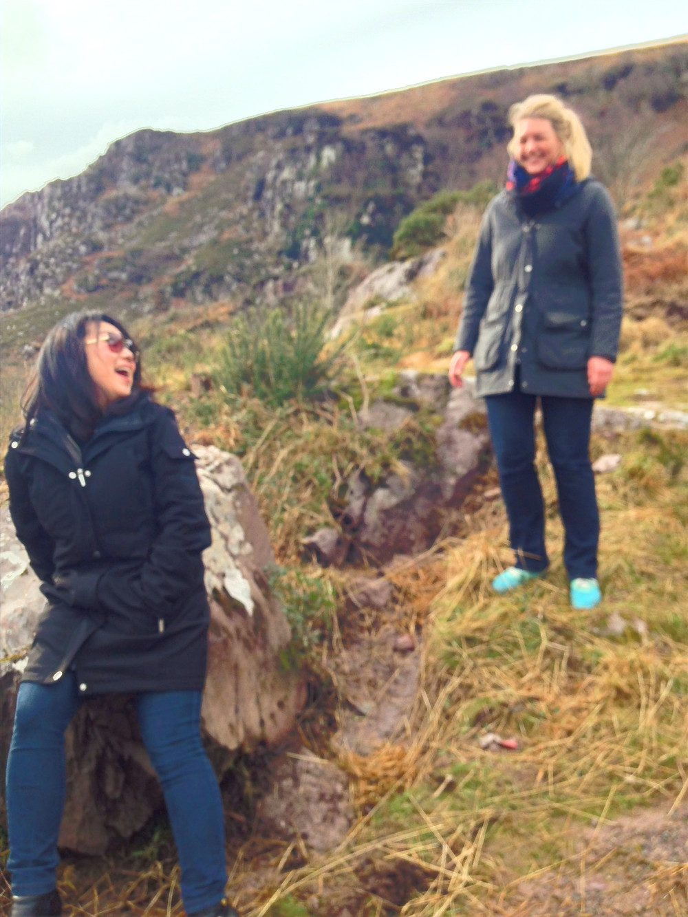 Two women, one Asian and the other Swedish, enjoying a moment at the Gap of Dunloe in Killarney Ireland