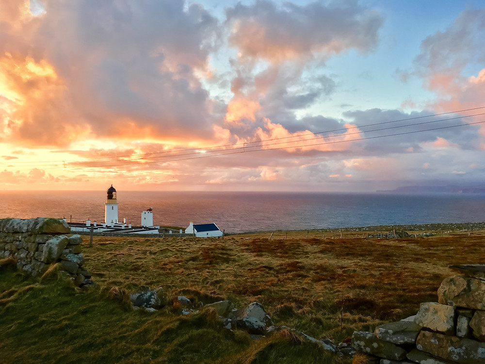 Sunset with Dunnet Head lighthouse in Scotland