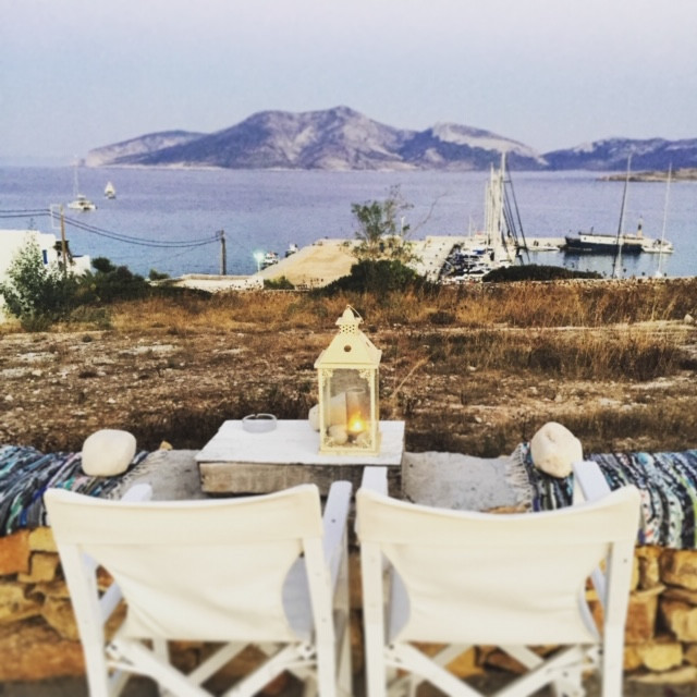 Two chairs facing the ocean on top of Greek island, Koufonisia.