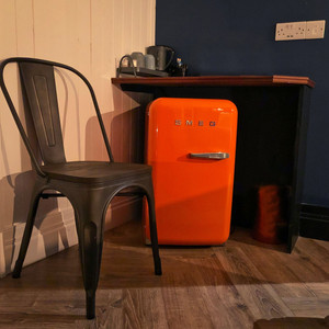 Attention to detail at The Continental Hotel in Galway, Ireland all the way down to vibrant orange Smeg mini-fridges