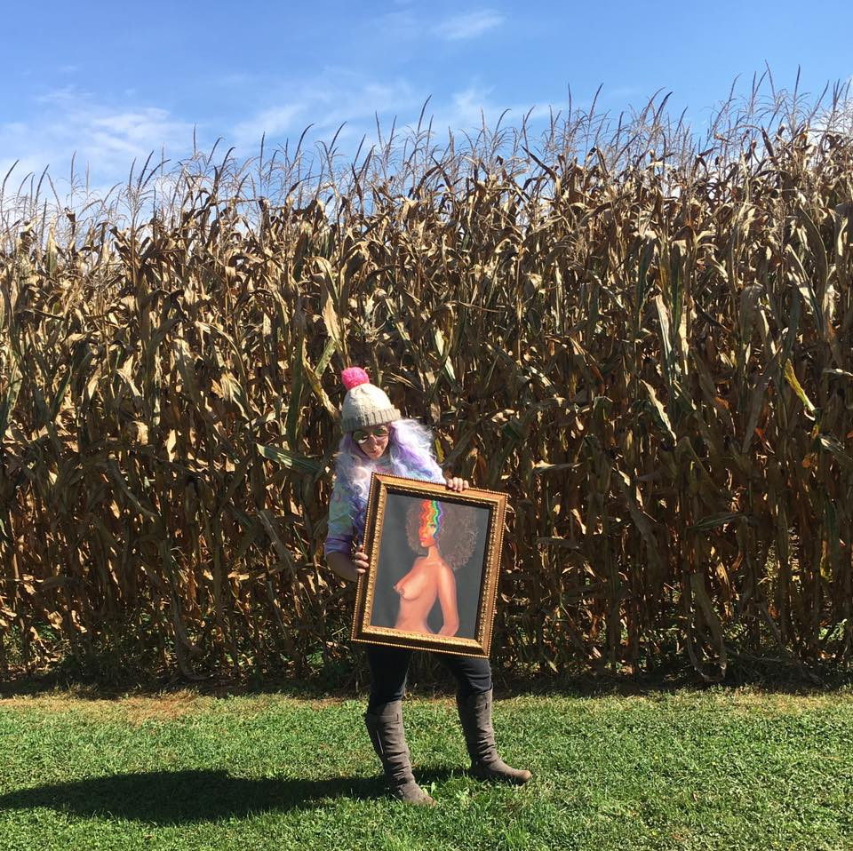 Krissy Whiski in a corn feild holding surreal trippy nude fine art in amish country