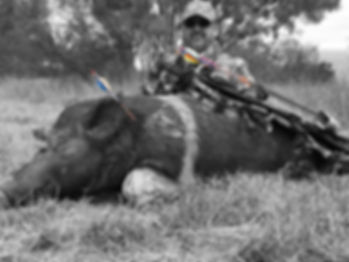 Page 10 and 11 Rick Valdez with big pig
