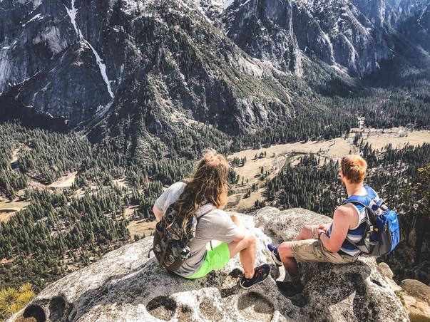 Jordan Honer and Joey Wallberg sitting on the cliff at the top of Yosemite Falls Trail