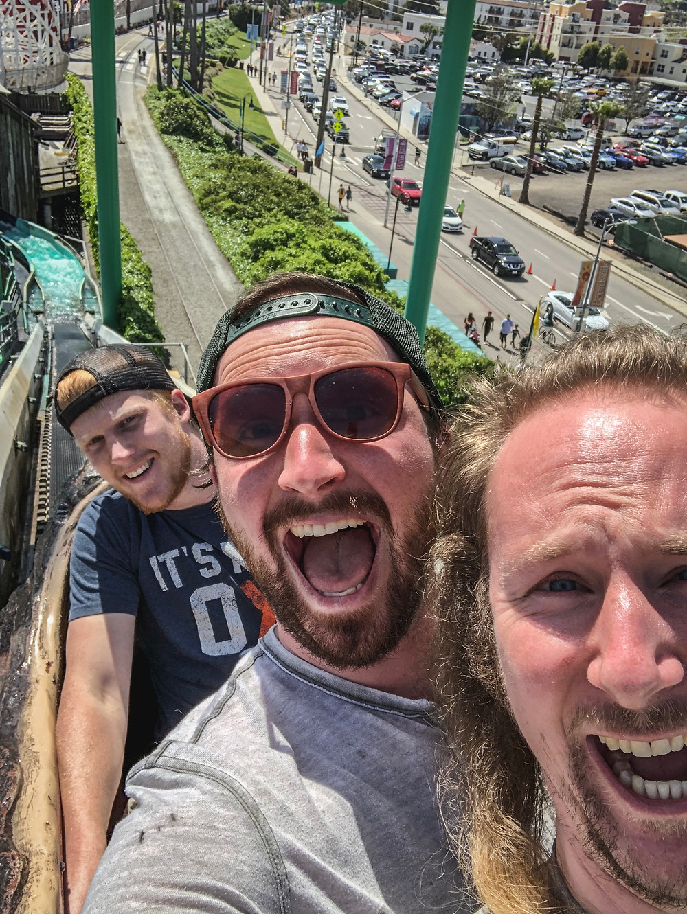 Sam Salerno, Jordan Honer, and Joey Wallberg riding the Logger's Revenge at the Santa Cruz Beach Boardwalk