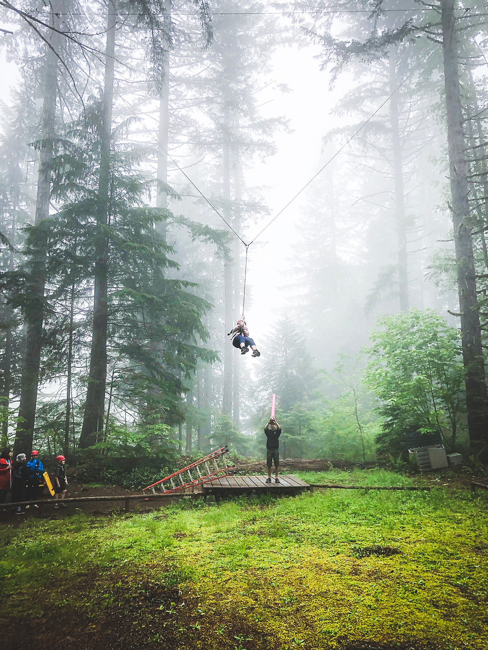Child on the Giant Swing in the woods at Camp Tadmor near Lebanon, Oregon