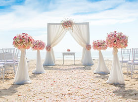 Romantic wedding ceremony on the beach .