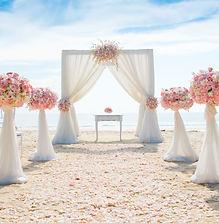 Romantic wedding ceremony on the beach .