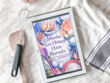 Relishing in Murder with Honey Ham Biscuits by A.L. Herbert