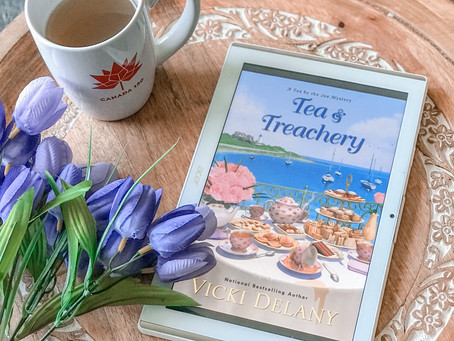 Cozying up with Tea & Treachery by Vicki Delany