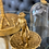 Thumbnail: GOLD HUNGRY MONKEY IN GLASS DOME