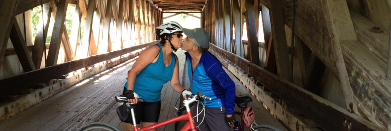 Kissing in covered bridge