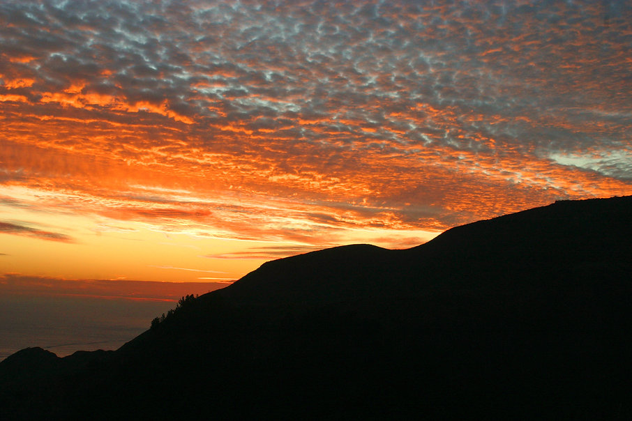 Color photograph by Peter Keresztury of the sunset by the Golden Gate Bridge. SIgned, titled, matted and framed.