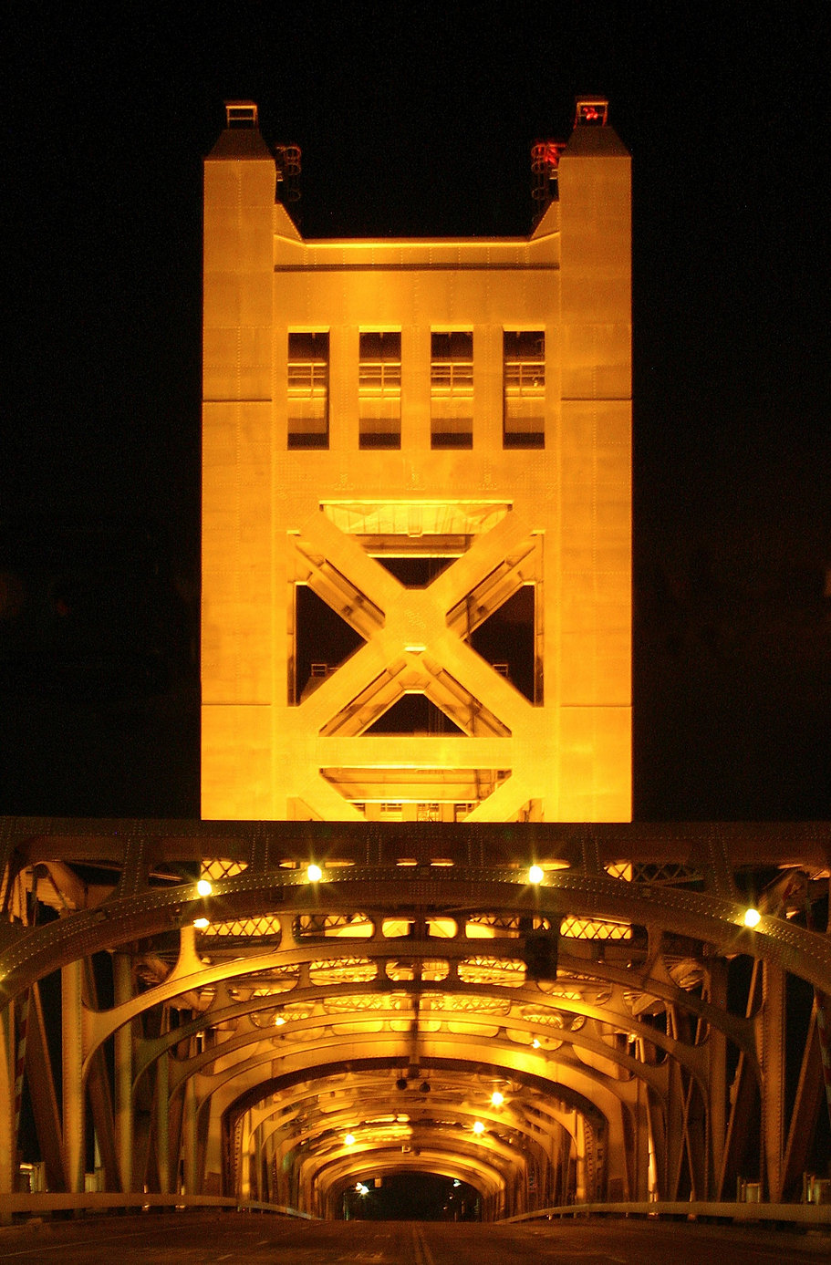 Color photograph of the mid 1930s lift bridge in Sacramento. Signed, titled, matted and framed