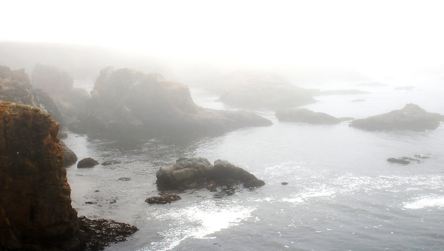 Color photograph by Peter Keresztury of the fog at Glass Beach in Ft. Bragg, CA.  Signed, titled, matted and framed.