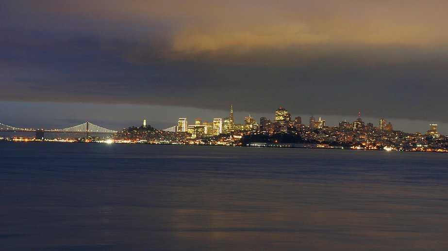 Color photograph by Peter Keresztury of looming clouds over San Francisco. Signed, titled and framed