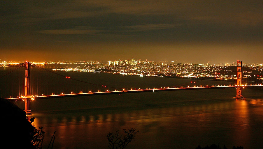Color photograph by Peter Keresztury of the Golden Gate Bridge and San Francisco at night, signed, titled and framed