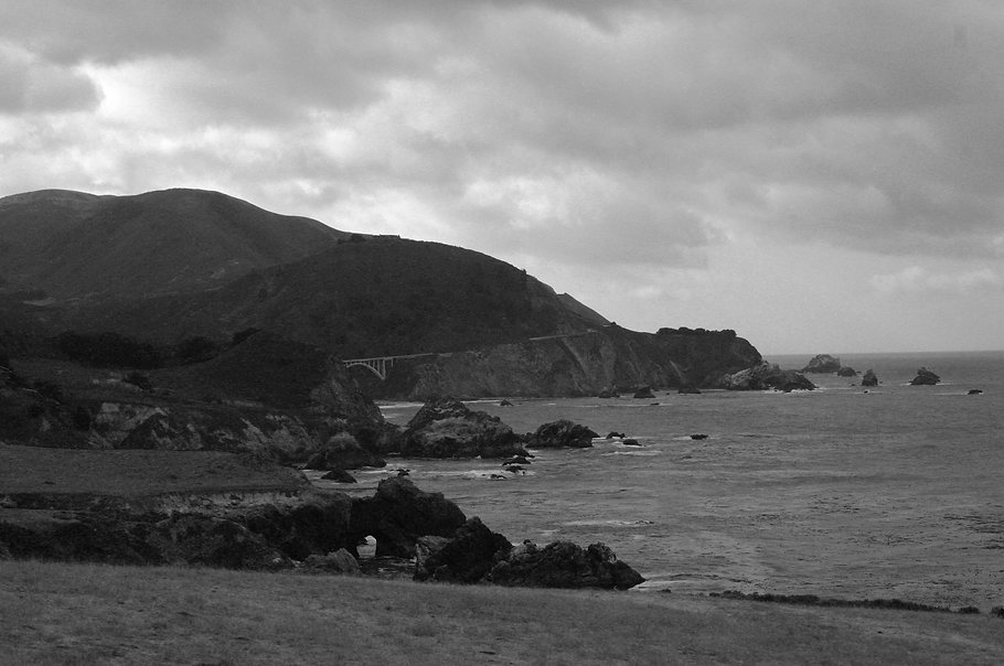 Black and white photograph by Peter Keresztury of the rocky coast line south of Carmel, CA. Signed, titled, matted and framed