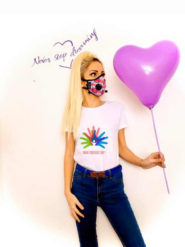 Never stop dreaming - Nicole on rare disease day holding a heart shaped balloon