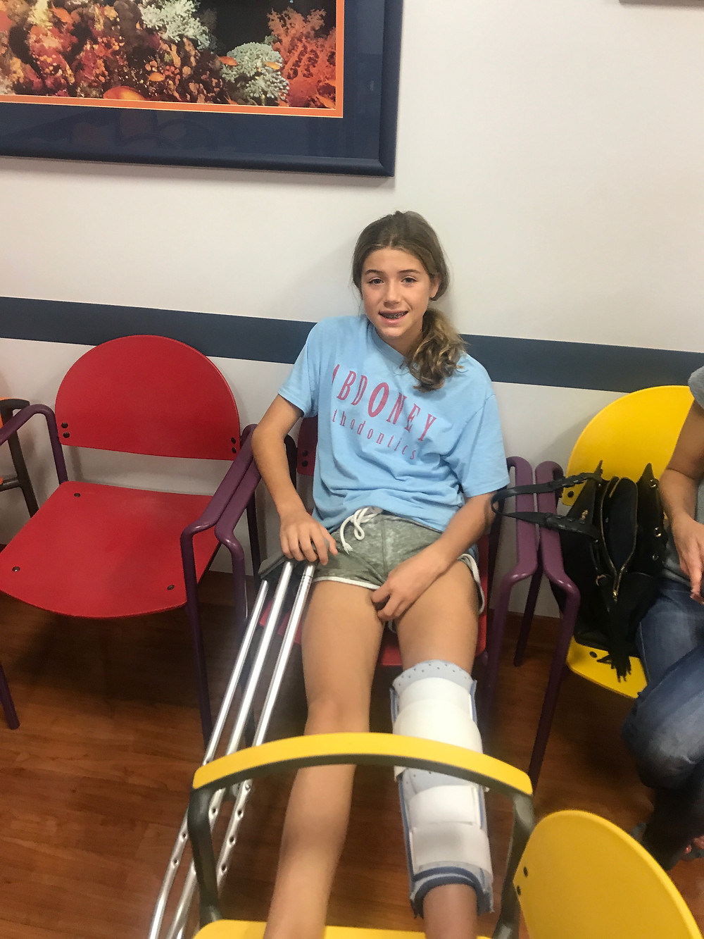 Claire in a leg cast and brace