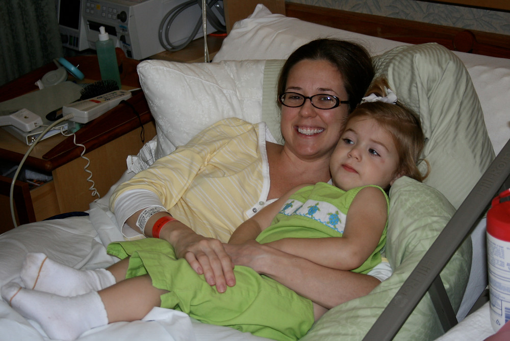 Claire with her mum is hospital bed