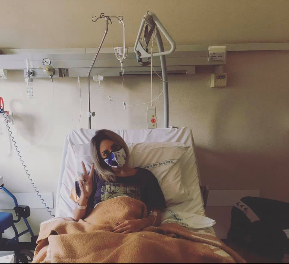 Nicole in a hospital bed having tests