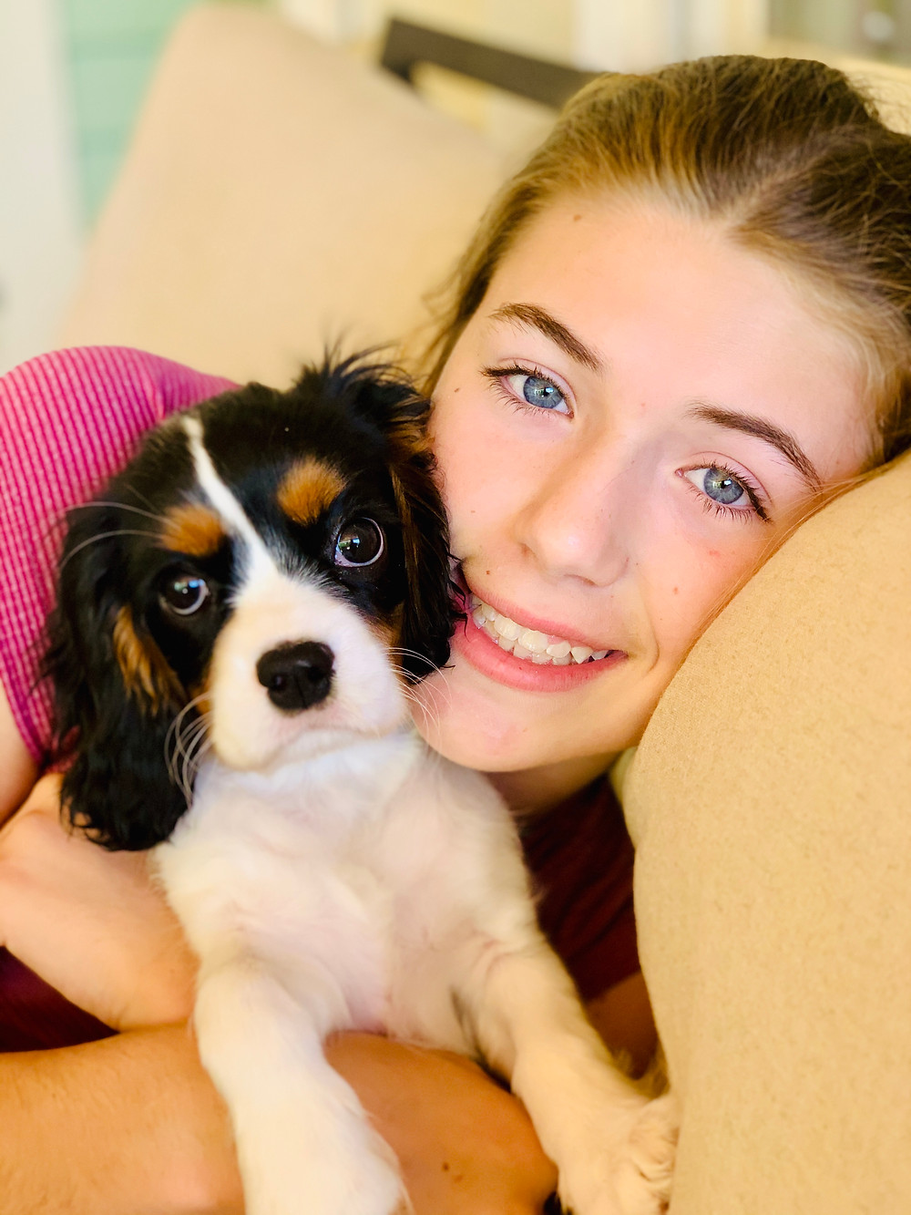 Claire enjoying cuddles with her puppy
