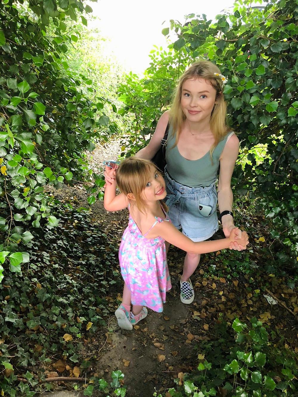 Megan and Libby dancing among trees.