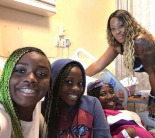 Shakarra, Nazhi and family - smiling through difficult times